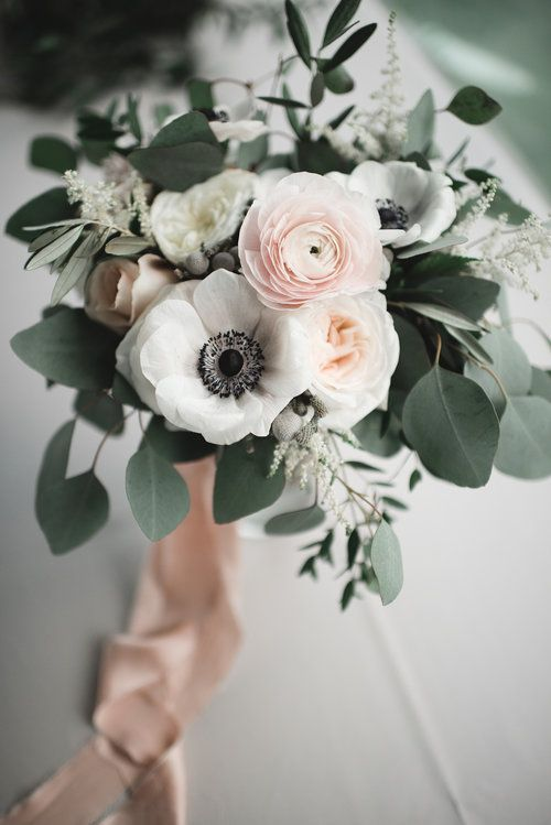 Blush and white bridal bouquet with garden roses, anemones, ranunculus, and eucalyptus greenery tied off with silk ribbon #weddingflowers #silkribbon #blushbouquet #virginiaweddingflorist