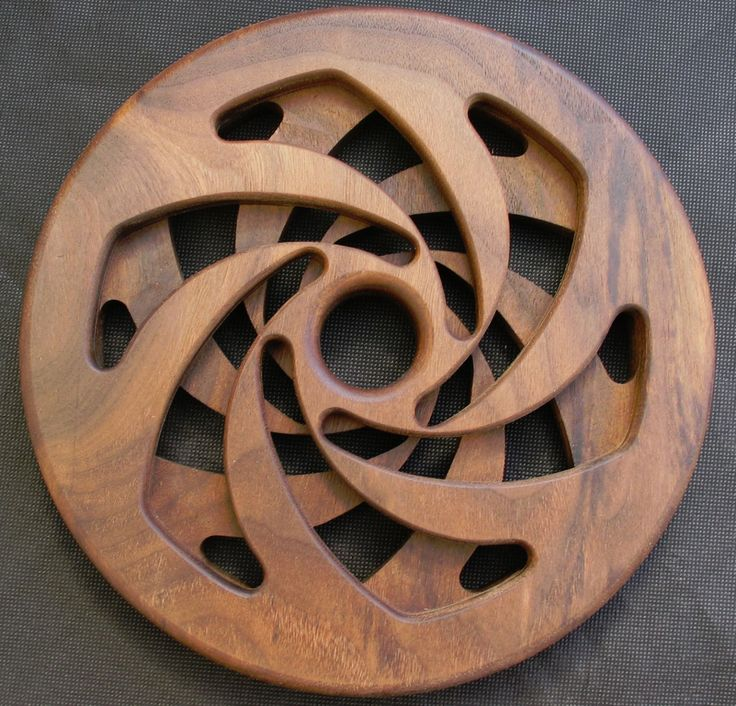Trivet - Worktop saver - Hand made - Black Walnut  Handmade 'Black Walnut' Trivet/Worktop saver/Hot Stand   230mmm Diameter (Approx)  Geometric patterns hand routed to high quality from one piece of wood by a skilled craftsman!
