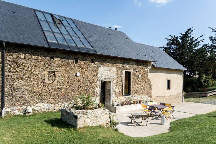 Façade Ouest, avec verrière sur le jardin d'hiver : Wiejskie domy od Briand Renault Architectes