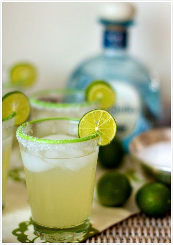 Agave Margaritas!  1 lime wedge  Kosher salt  Ice  2 ounces silver tequila  1 ounce fresh lime juice  1 ounce light agave nectar  opt: blackberries muddled in bottom of glass