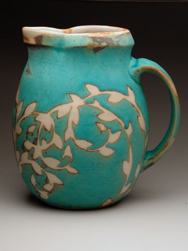 Julie Covington | Jug - Wheel-thrown stoneware glazed with shino, decorated with wax resist and other traditional reduction glazes.