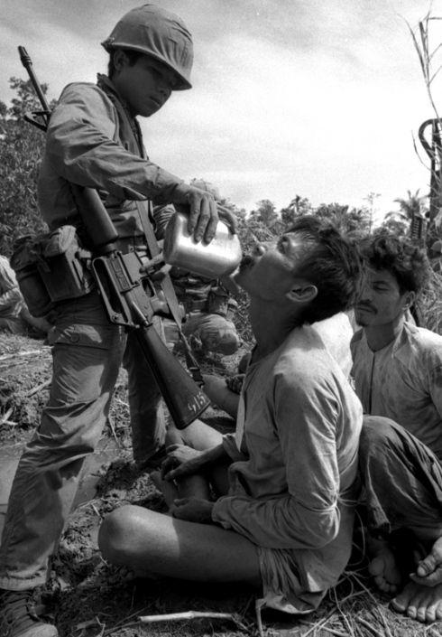 viet cong   Viet Cong prisoner gets a drink of water, 1967 ...