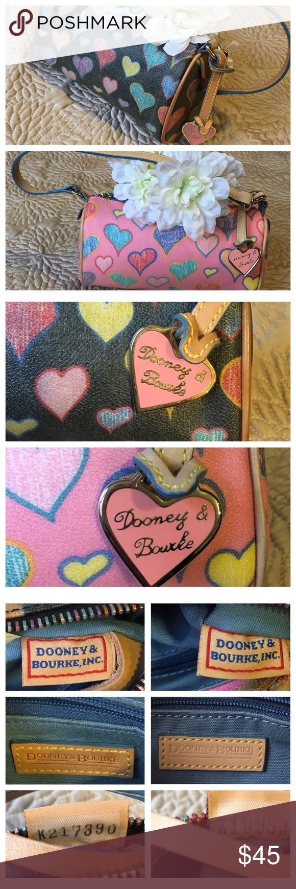 Dooney and Bourke Lot of 2 HandBags 2 Vintage Dooney and Bourke Handbags!   Features:  🔹Signature heart charm 🔹Attached interior key ring holder  🔹Multicolored zipper 🔹Dooney and Bourke signature on the exterior leather.  Pre-owned Condition: mild fading/stains at the beige perimeter of each purse; inside of both purses generally clean (no major stains). Dooney & Bourke Bags Shoulder Bags