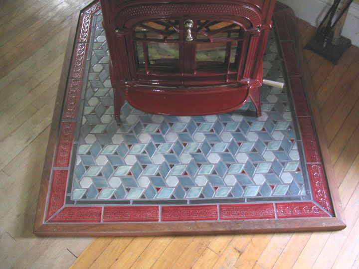 Swell Tile Work To Compliment Red Enamel Wood Stove