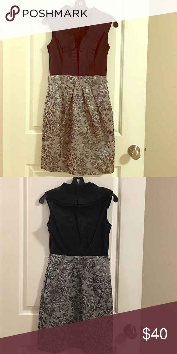 BCBG MAXAZRIA black and silver dress This dress is in excellent condition but does not come with a belt. It has never been worn and tags are still attached. BCBGMaxAzria Dresses Midi