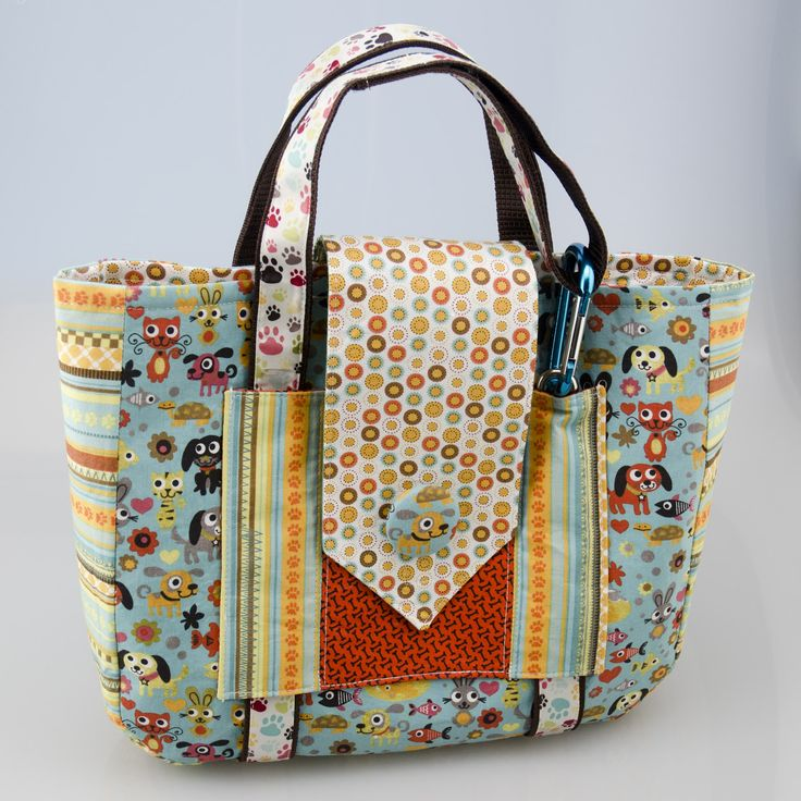 """DOG PURSE supposedly to carry all dog stuff when you travel. I'm thinking it is just a neat bag.  Approximate finished size: 2"""" x 10"""" x 12"""""""