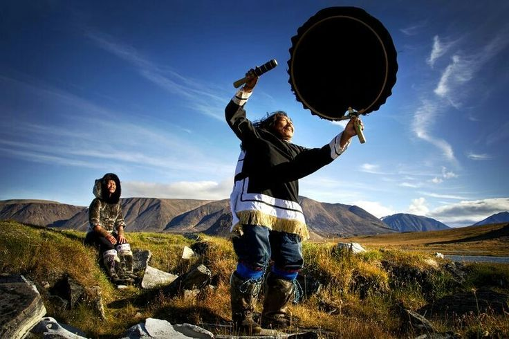 DECEMBER 10, 2017DRUM DANCE  Two Inuit people perform a traditional song and drum dance on Devon Island, in Canada's Northwest Passage.  PHOTOGRAPH BY MICHELLE VALBERG