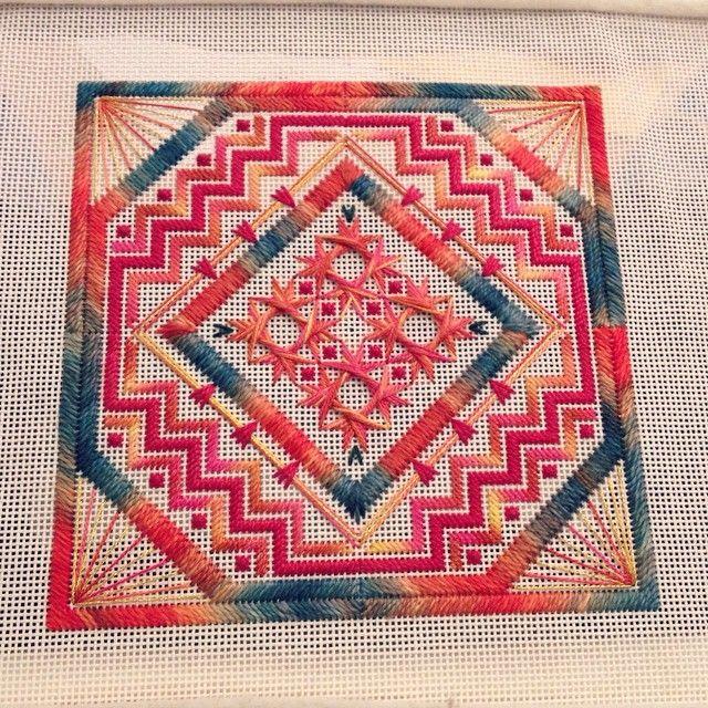 Needlepoint canvaswork featuring walneto stitches