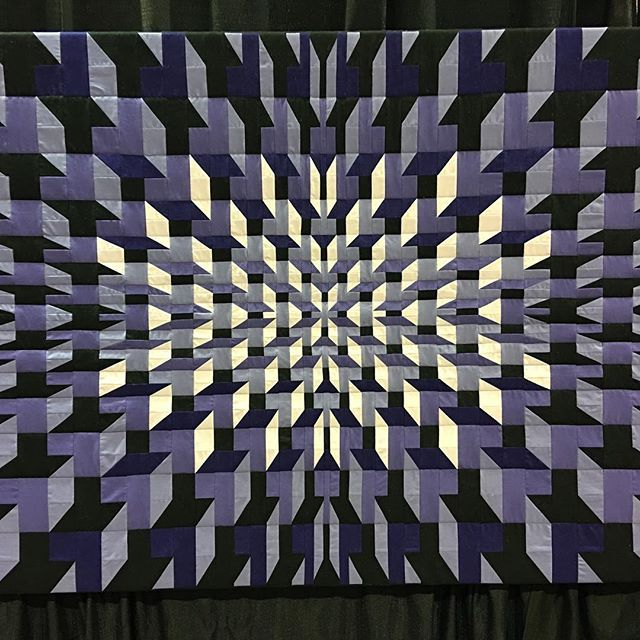 Purple Prisms by Wayne Rhodes. A variation on the traditional tumbling blocks. #rocksmyquiltingworld. at the International Quilt Festival in Chicago #quilting