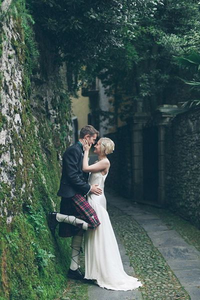 Scottish traditions shined throughout this couple's romantic wedding in Italy — we love how this photo subtly put the emphasis on the groom's kilt.