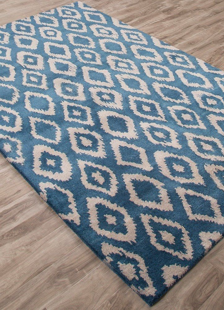 Ikat rugs bring global design sensibility with traditional artisan motifs. Our indigo blue ikat rug is hand tufted in soft wool. Where to buy rugs online.
