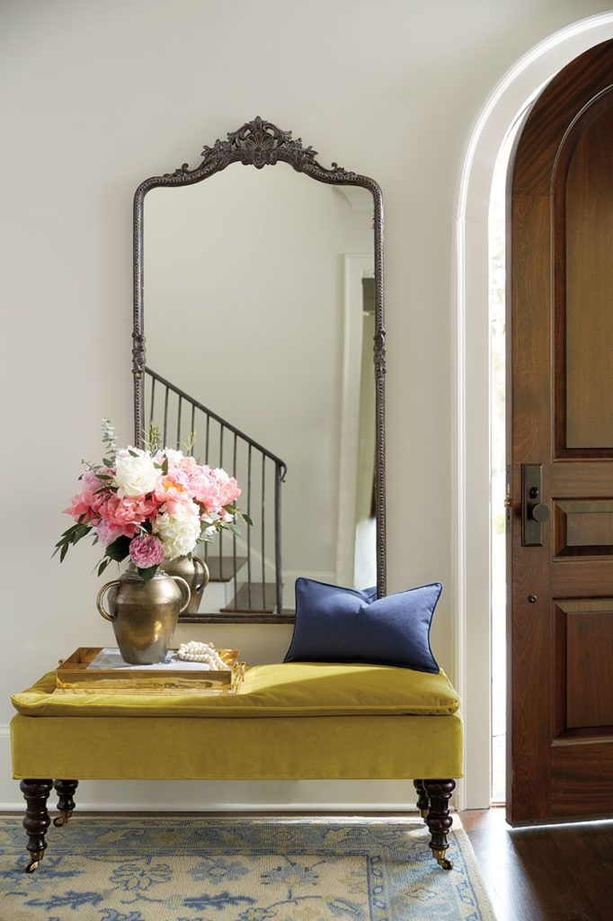Filling a Blank Entryway: Make a grand entrance with a large-scale mirror and a velvet pillowtop bench!
