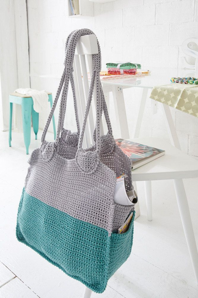 Blue crochet tote perfect for all your shopping and spring outings! Download the FREE pattern on the LoveCrochet website.