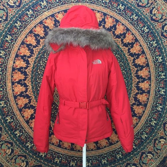 PRICE REDUCED!! Red North Face 550 Greenland Coat I purchased this coat several years ago but I've only worn it a couple times. It is very heavy weight and great for cold weather but living in Ky I just never wear it. It's not new but is like new. Obviously it's Red and has grey lining and removable grey fur around the hood and pulls. It has a zipper and Velcro up the front with a red belt and red buckle and front side zip pockets. Like many other Northface coats it has  other hidden zip up…