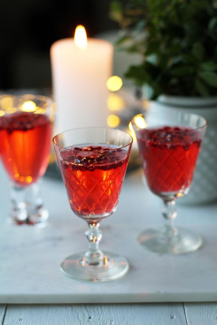 Scandinavian glögg sparkling wine cocktail with pomegranate seeds