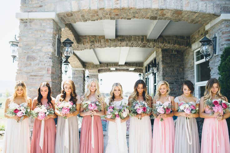 Total bridesmaid dress inspiration as we dressed these ladies in different colors including cream, gray, light pink and dark pink. Soft, long, chiffon dresses complimented the bride's lace wedding gown.  Picture from the wedding we planned for Dancing With The Stars professional dancer, Lindsay Arnold