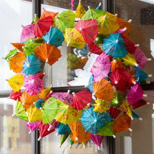 Cocktail Umbrella Wreath - This DIY summer wreath is colorful and quirky.