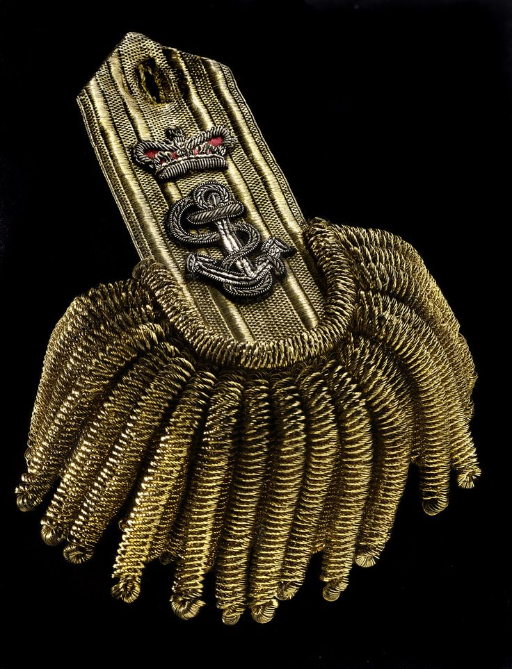 Pair of captain's epaulettes belonging to J. Stockham (died 1814). The regulations of 1812 stipulated that captains should now wear two epaulettes with insignia that indicated their rank: the fouled anchor and a crown. The epualettes have 20 large bullions and 17 small ones. On the shoulder pad of each is an embroidered 'S'. Royal Navy uniform regulations 1812-1825