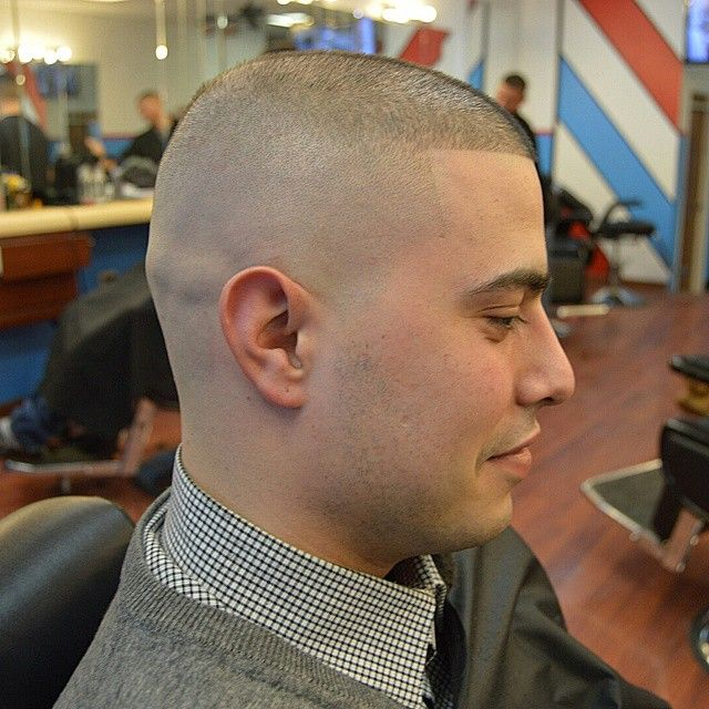 Something is. warner madrigal shaved head