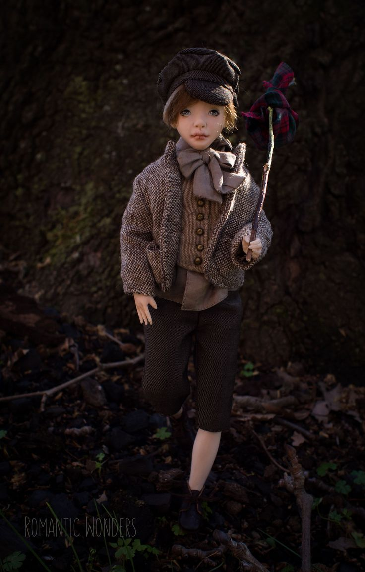 https://flic.kr/p/qQ7pLW   Oliver Twist.Handmade Art doll. By Romantic Wonders.   Oliver was sculpted of polymer clay with strong steel armature inside. All clothes (two sets) were sewed by the hand of cotton,linen and silk fabrics, shoes were sewed of real leather, hair was made of mohair.