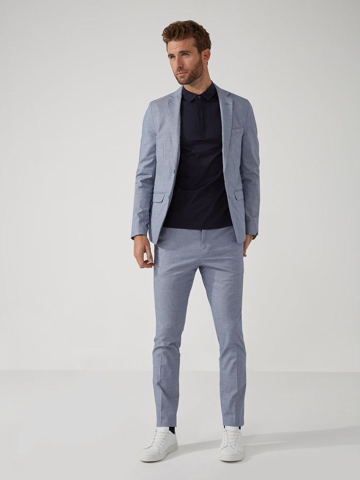 Wearing a blazer goes from snore to score when colour and texture get involved, and this blue chambray has got the right approach going for it. Denim-esque stretch cotton and casual construction tone down a quasi-formal piece, for relaxed wear - even i