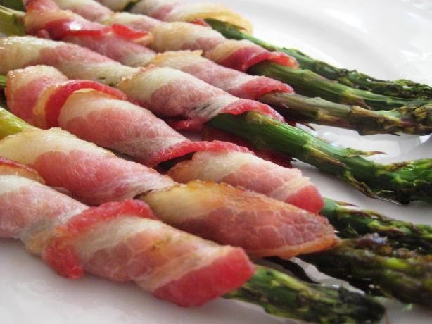 Bacon-wrapped asaparagus= yummy but I laid the bacon over top not wrapped...