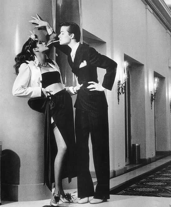 """""""Le Smoking"""". Gia Carangi and unknown model in YSL Rive Gauche, photographed by Helmut Newton for Vogue Paris, 1979. Smoking tuxedo for women, brought back from the past."""
