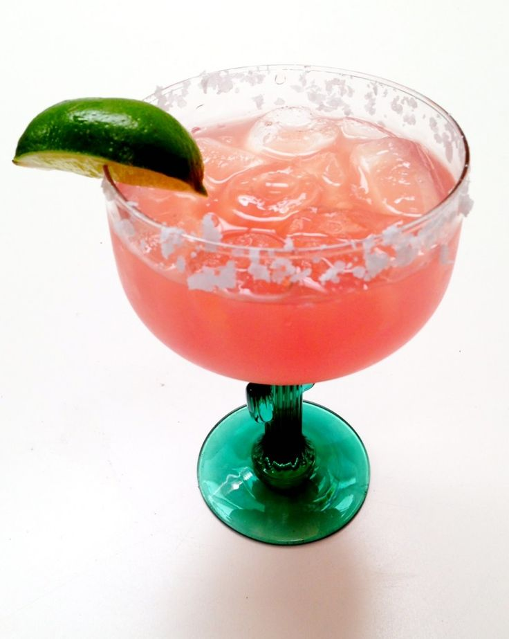 pink margaritas  Ingredients:  1 12-ounce can of frozen pink lemonade concentrate (thawed)  12 ounces of tequila  12 ounces of Grand Marnier  Ice cubes  Salt (to rim the glasses, if desired)  1 lime (cut in wedges)