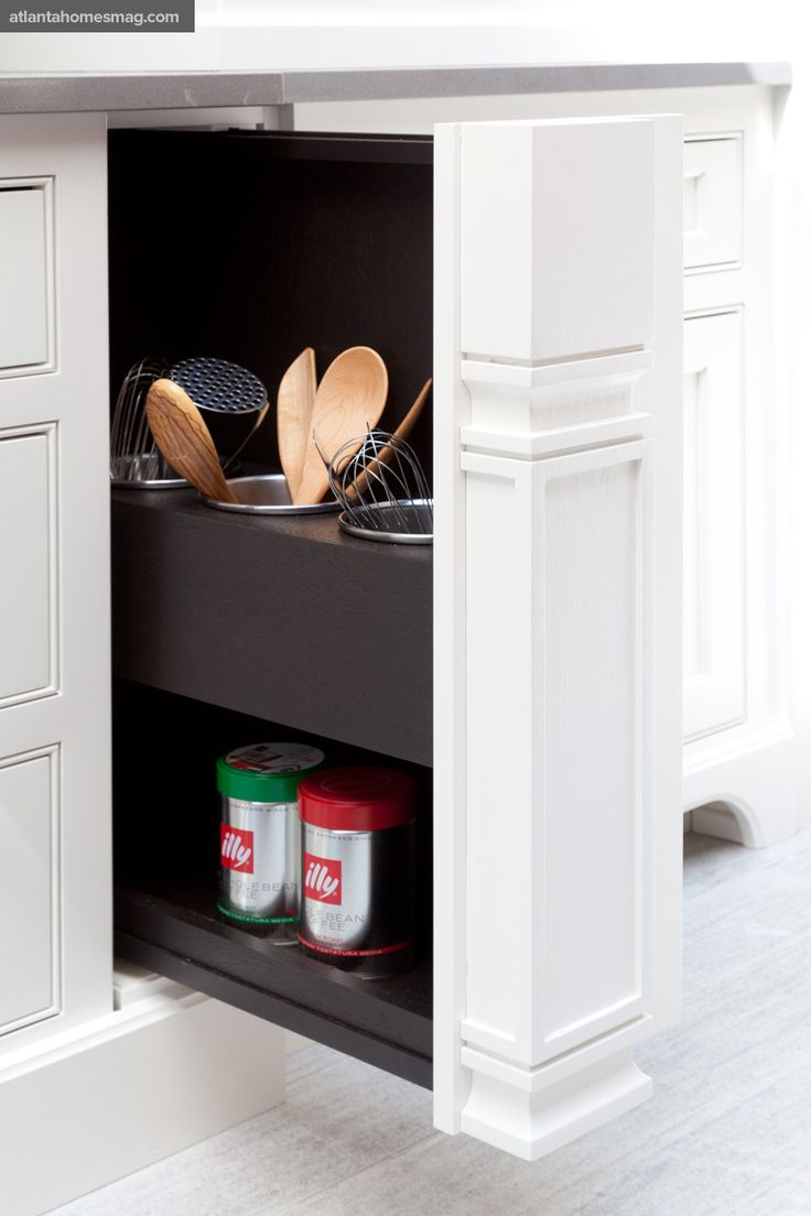 storage for cooking utensils & clean counter space!!!  If I ever get to design my own kitchen, this is a must!!!