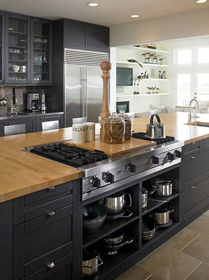 black kitchen design. I love the open shelving under the cook top for easy access to pots/pans.