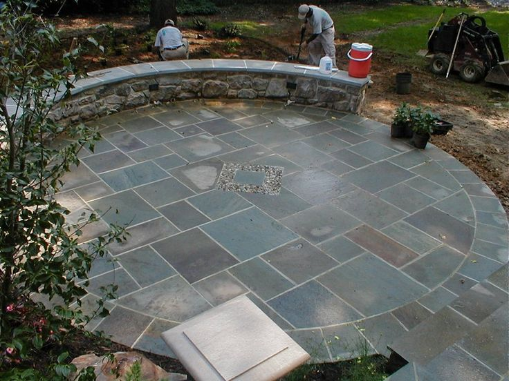 Round Patio walled flagstone patio w/ center accent & circular border cut-in