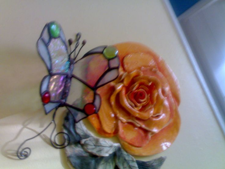 Butterfly and ceramic flower