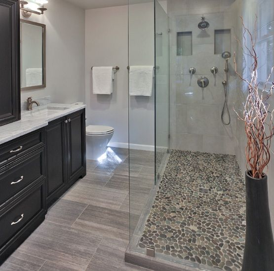 Pebble shower floor in small frameless showers
