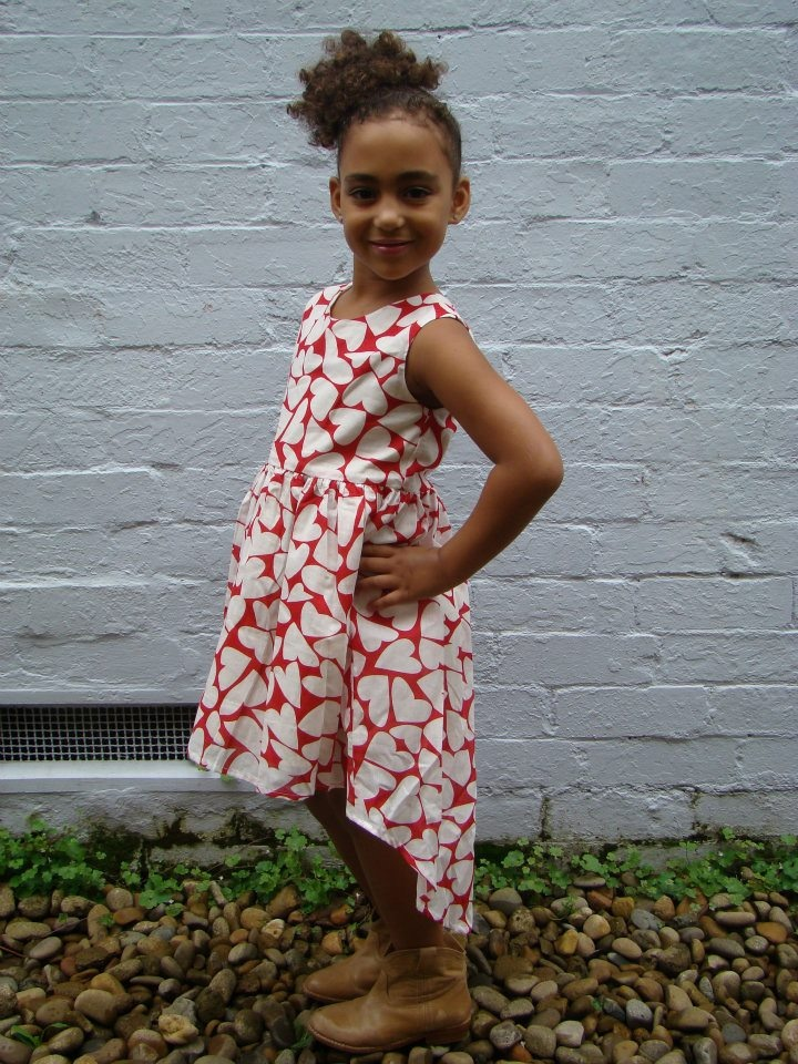 Tik e ta kids Summer Collection 2011: Lory Dress - Scoop neck dress with long back hem in Red/White heart print on cotton voile. Sizes 2-8.