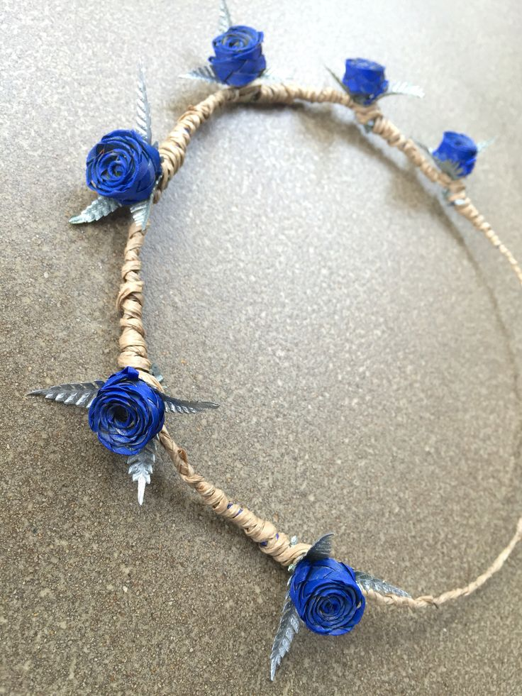 Vibrant blue halo with silver fern. www.flaxation.co.nz