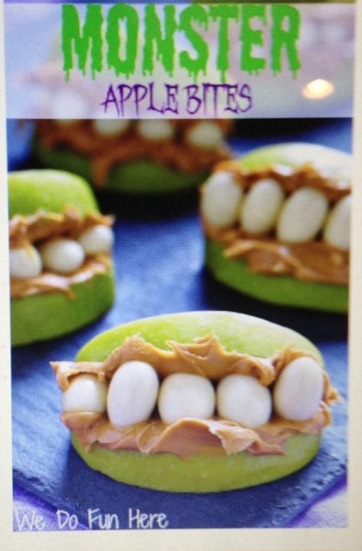 Cute Halloween snack idea:  apple slices, peanut butter, and yogurt covered raisins!