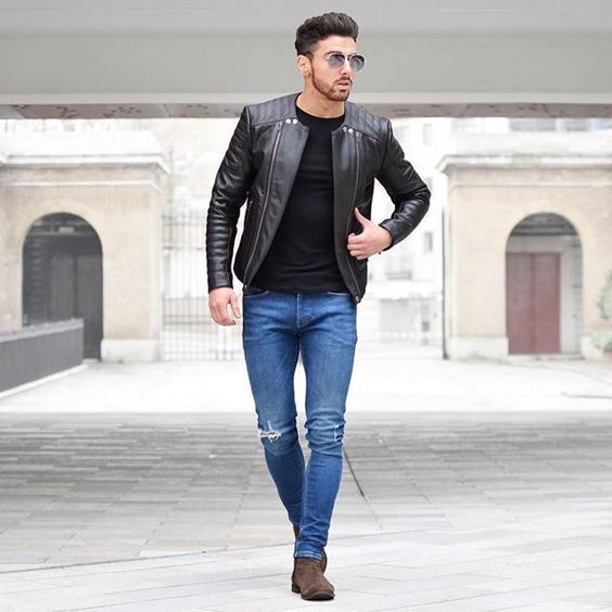 This combination of a black leather bomber and blue slim jeans is perfect for off-duty occasions. Turn your sartorial beast mode on and make dark brown suede chelsea boots your footwear choice.   Shop this look on Lookastic: https://lookastic.com/men/looks/black-bomber-jacket-black-crew-neck-t-shirt-blue-skinny-jeans/19996   — Black Crew-neck T-shirt  — Black Leather Bomber Jacket  — Blue Skinny Jeans  — Dark Brown Suede Chelsea Boots