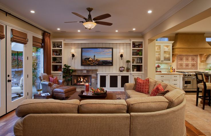 A large sectional sofa and leather armchair provide plenty of seating, while the room's open floor plan and proximity to the kitchen makes it easy to entertain friends and family.