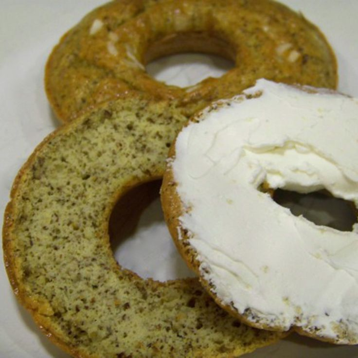 Low carb bagels can be easily made at home with a donut mold pan. These gluten free onion bagels are made with flax and coconut flour.