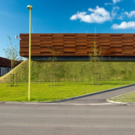 This gas compressor station in southern Denmark by CF Møller Architects comprises Corten steel-clad boxes atop a pair of artificial hills.