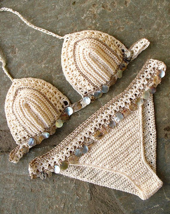 Lace crochet bikini embellished with shells . Crochet swimsuit made of high quality yarn. Retro, boho chic style. Sure to be a favorite on the beach or at the pool. The bra cups are well shaped and adjustable due to the cords to bind, so you can adjust it how you need. The bottom is low, Brazilian bikini. Fully lined with stretch-grid fabric, very soft and tender to skin. You can choose from XS to XL size. Look at the dropdown menu. Cup sizes from A to D are available. Keep in mind that af… – nesrin gönenli