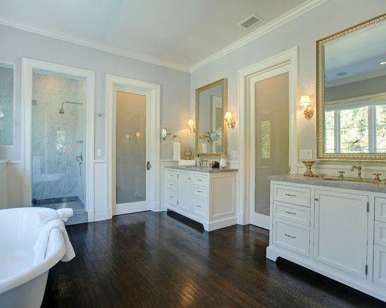 Cool grey walls white cabinets dark brown floor  White