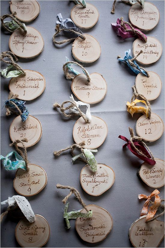 escort card ideas - would match the wood slabs for the centerpieces.