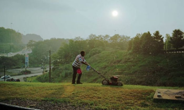 PITTSBURGH (MAN CUTTING GRASS), 2004 FROM A SHIMMER OF POSSIBILITY BY PAUL GRAHAM For two years photographer Paul Graham traveled the US. The above photograph was taken when the sun shone through ...