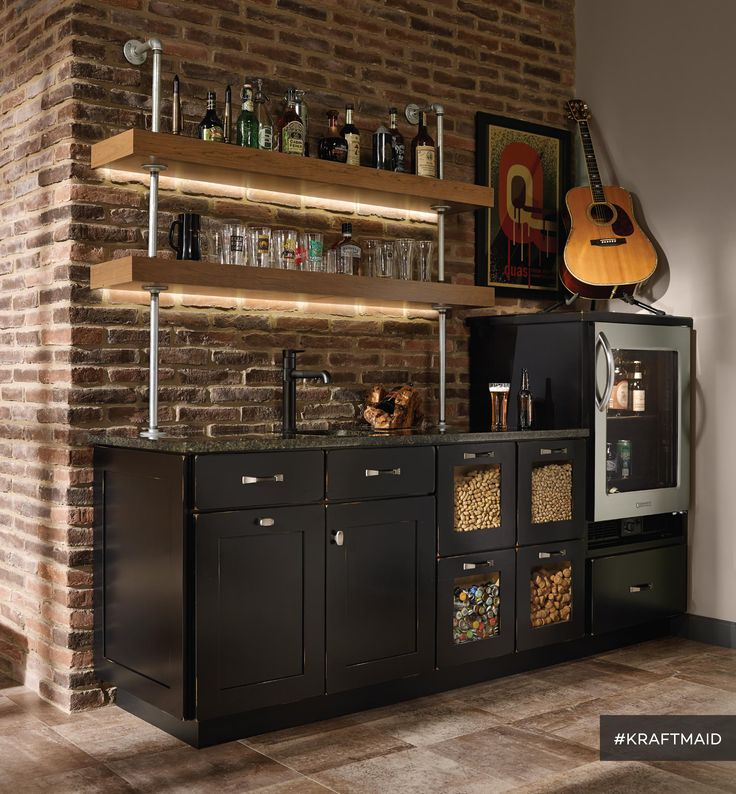 This bar area is for the relaxing-with-a-drink crowd and provides several kinds of storage to keep some stuff hidden and some on display. (Cherry cabinets in Vintage Onyx)