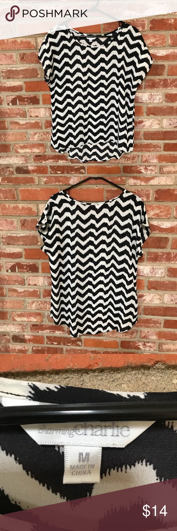 Charming Charlie black and white chevron top (69) Worn and washed once! Excellent condition black and white chevron hi-low blouse. Size medium  21 inches armpit to armpit  24 inches long in the front  29 inches long in the back I accept reasonable offers! Bundle multiple items for a private offer 💜 Charming Charlie Tops Blouses