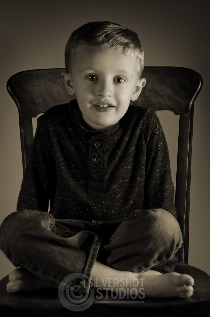 Black child sitting in chair - Boy Chair Sitting Black And White