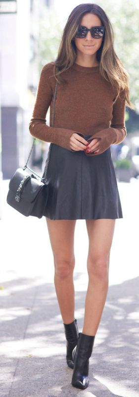Chic and ready to rule the world + Arielle Nachami + A-line mini skirt + black leather.  Mini skirt: Love Leather, Top: Zara, Shoes: Christian Louboutin, Purse: Valentino, Sunglasses: Bottega Venetta