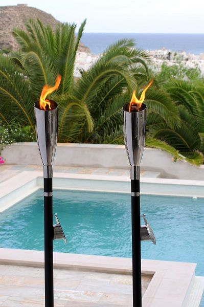 Shiny steel Pisa Oillamp with black pole just timeless design with wide flame tecknology gives you more flame and light and is also wind resistant at the same time.