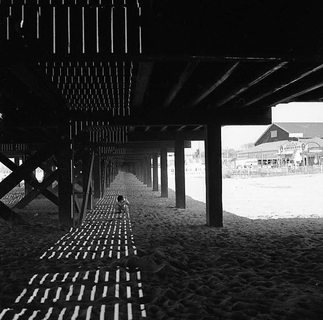 Untitled (shadows and figure under boardwalk), Vivian Maier   1955
